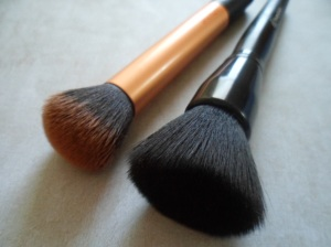 L to R: Real Techniques Buffing Brush - e.l.f. Studio Powder Brush