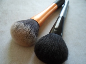 L to R: Real Techniques Powder Brush - Face Secrets Deluxe Powder Brush